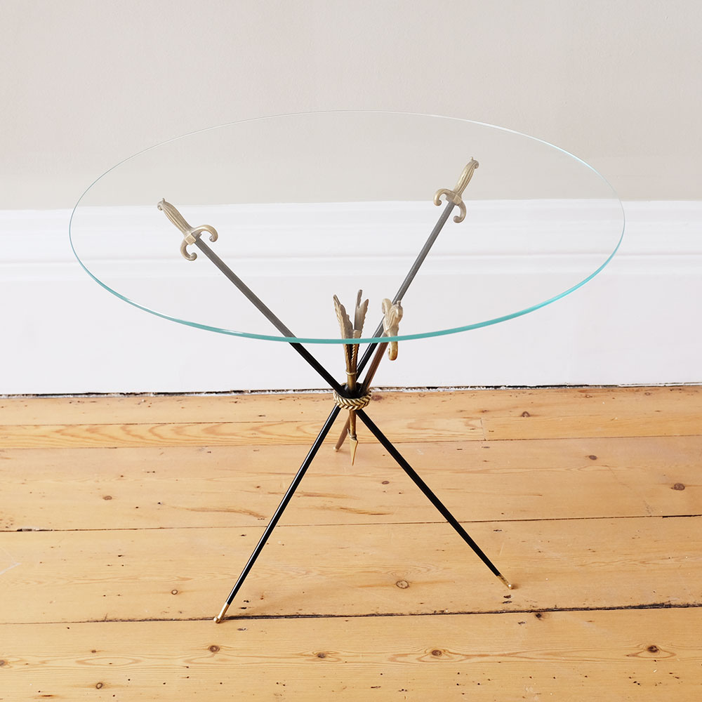glass-coffee-table-with-arrows-and-swords